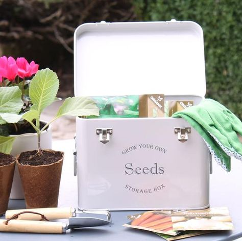 These beautiful seed packet storage tins are perfect for collecting, storing and keeping seed collections organised and dry. Made from powder-coated steel, complete with metal handles, making it easy to move from the shed or house to the garden. The lid is hinged, and clasps hold the lid secureInside are 3 compartments, enough space for a huge number of seed packets or store plant labels and mini seed planting tools too.Please note that the price is just for the seed tinHeight 18cm x Width 23.5c