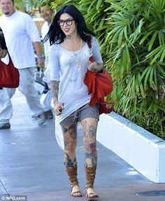 All smiles: Kat Von D grins and flashes her engagement ring as she joins friends for lunch in West Hollywood yesterday