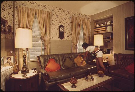 Sandra Bruno Straightens a Pillow in the Immaculate Living Room of Her Family's Home at 39 Neptune Road