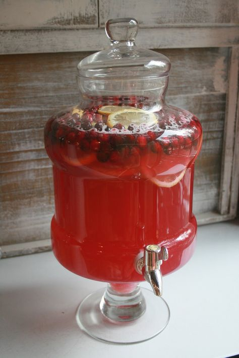 Christmas punch - one part lemonade, one part cranberry juice, one part ginger ale, a bag of cranberries and two sliced lemons.