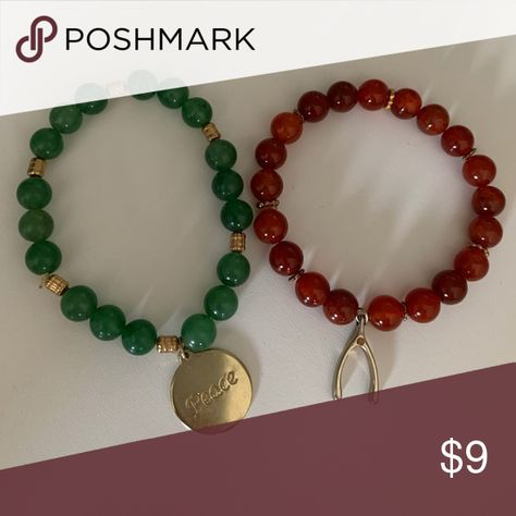 Ladies Beaded Charm Bracelet This set includes a dark green and a ruby bead bracelet. The green bracelet has a disc that says 'peace' and the ruby bracelet has a wishbone. Bracelets are stretch Handmade Jewelry Bracelets