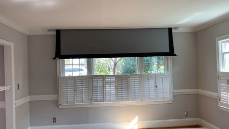 """Recessed projector screen completely disappears from view.  Great option to get a 120"""" screen in a formal living room."""