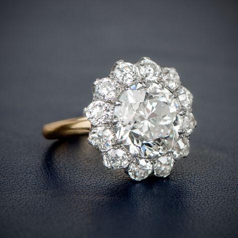 A Stunning and Rare Edwardian Era Inspired Cluster Engagement Ring, featuring an Old European Cut Diamond. anillos de compromiso   alianzas de boda   anillos de compromiso baratos http://amzn.to/297uk4t