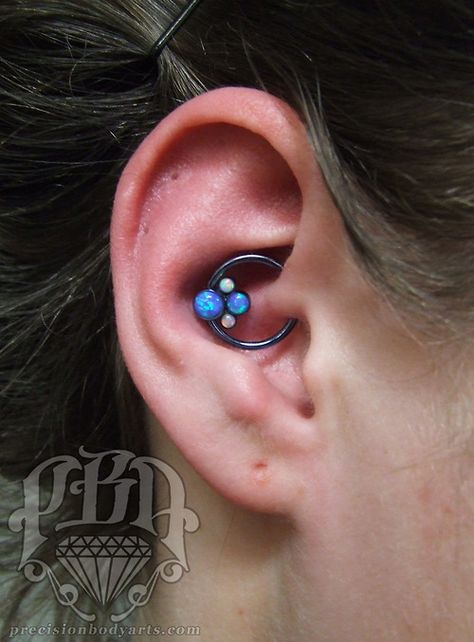 Daith piercing by Ryan Ouellette with Anatometal cluster. Precision Body Arts in Nashua, New Hampshire.