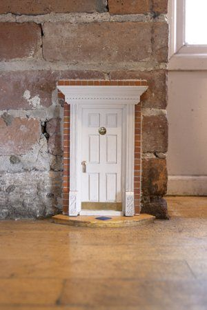 fairy door, I think this would be really fun and whimsical in a little girls room.