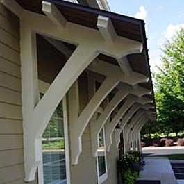 Wood Bracket Supports For Angled Roof Overhang Custom Pitch House With Porch Building A Porch Roof Overhang
