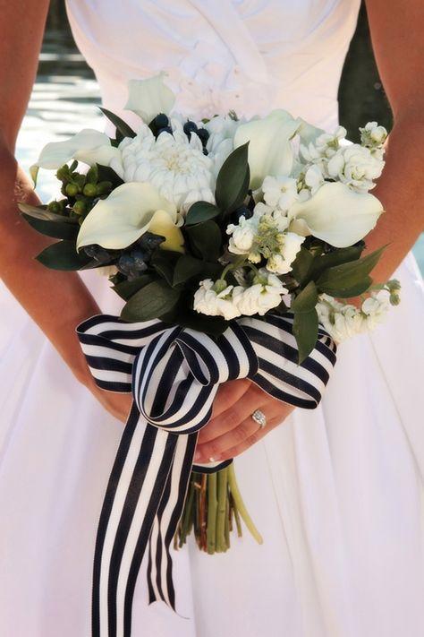 black and white ribbon around a white floral wedding bouquet. preppy and pretty bride!