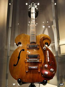 A custom-built guitar played by Beatles legends John Lennon and George Harrison has sold for $408,000 (£269,000) at auction in New York. (via BBC News)
