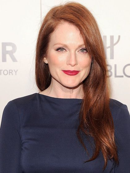 Julianne Moore deep part, side-swept hairstyle with a classic red lip | allure.com
