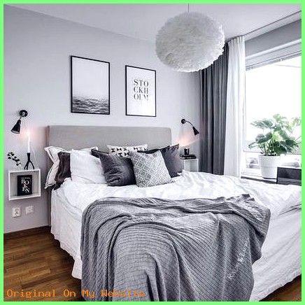 Schlafzimmer Deko Schlafzimmer In Grau Weiss Mit Kuschligen Decken Und Bildern Uber Dem Bett Zimmer Bilder Uber Bett Zimmer Einrichten