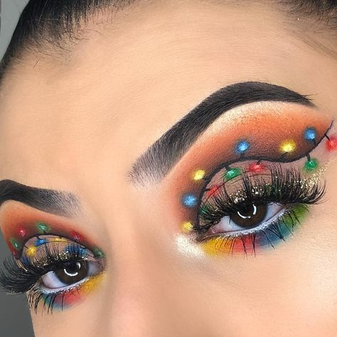Christmas Makeup Look Ideas!  From Christmas lights to Santa hats and reindeer on the eyes, there are so many bold, colorful, and creative Christmas makeup looks this year.