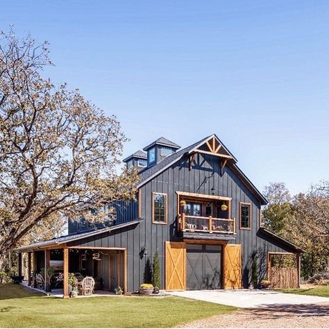 28 dark exterior ideas to give you inspiration to revolutionize your house. Add contrast with stone and wood, or keep it monotone to add a dramatic element. Pole Barn House Plans, Pole Barn Homes, Pole Barns, Barn Style House Plans, Horse Barn Plans, Rustic House Plans, Garage Plans, Dream House Plans, Metal Building Homes