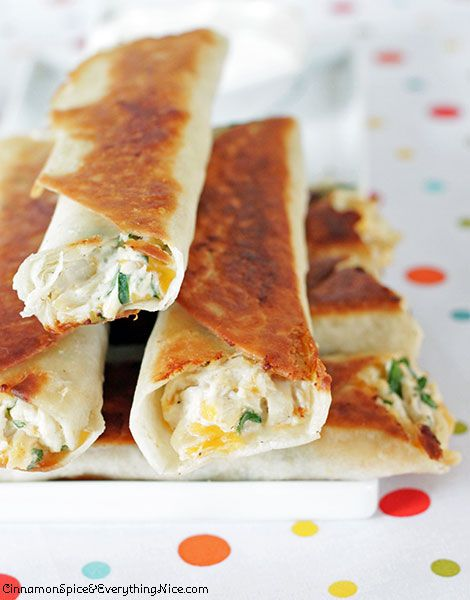 Chicken and Cream Cheese Taquitos ~ Tortillas rolled with a shredded chicken, cream cheese, cheddar, salsa and spinach filling... They have an addicting crunch that gives way to creamy, cheesy insides