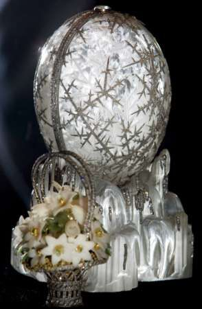 "The Winter Egg ---- considered by experts to be the most beautiful of all of the Faberge Eggs. Nicholas II had this made for 1913. The ""surprise"" inside is a basket of flowers to represent Spring."