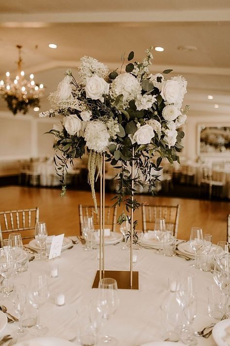 Tall centerpieces in gold stands with white hydrangeas, dahlias, roses, larkspurs, Amaranthus and greenery. White Hydrangea Centerpieces, Gold Wedding Centerpieces, White Wedding Flower Arrangements, White Wedding Decorations, Greenery Centerpiece, White Centerpiece, White Hydrangeas, White Roses Wedding, Marie
