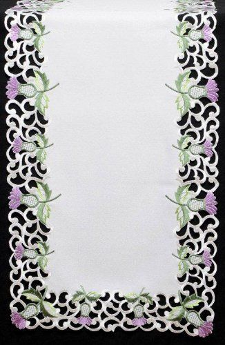 Table Runner (Small) in a White Balmoral Thistle Design by Celtic Glass Designs. $25.00. Dimensions: 14 x 36 inches. Ideal for your dining table at Hogmanay, Burns Night, St Andrew's Day, Christmas, Mother's Day, Easter and also for your Scottish Wedding, Engagement Party or other Scottish celebrations and events.. Celtic Glass Designs presents Justina Claire's beautifully embroidered table linen to grace your dining table. Beverley Gallagher of Celtic Glass Designs sp...