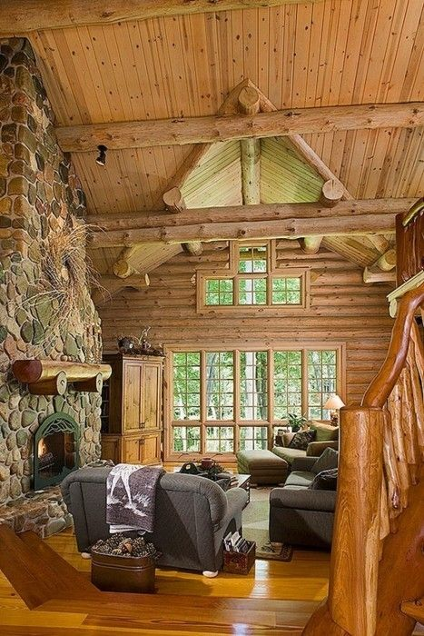 Rustic stone fireplace, beam ceiling.