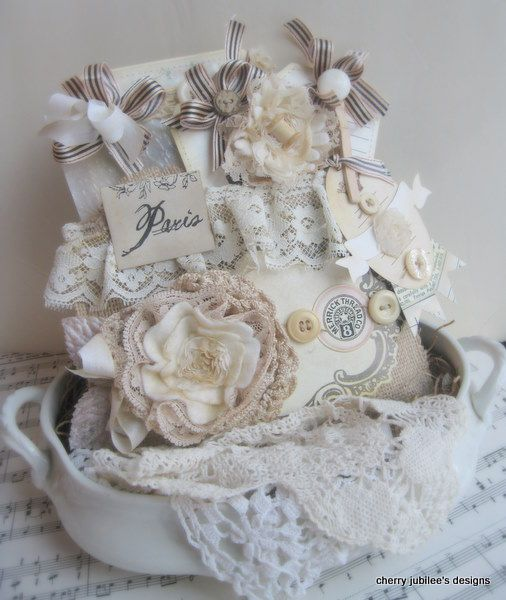 This is just amazing ... a card with a burlap pocket filled with sweet tags.  And that layed flower is amazing!  And of course it was made by Cherry Nelson!