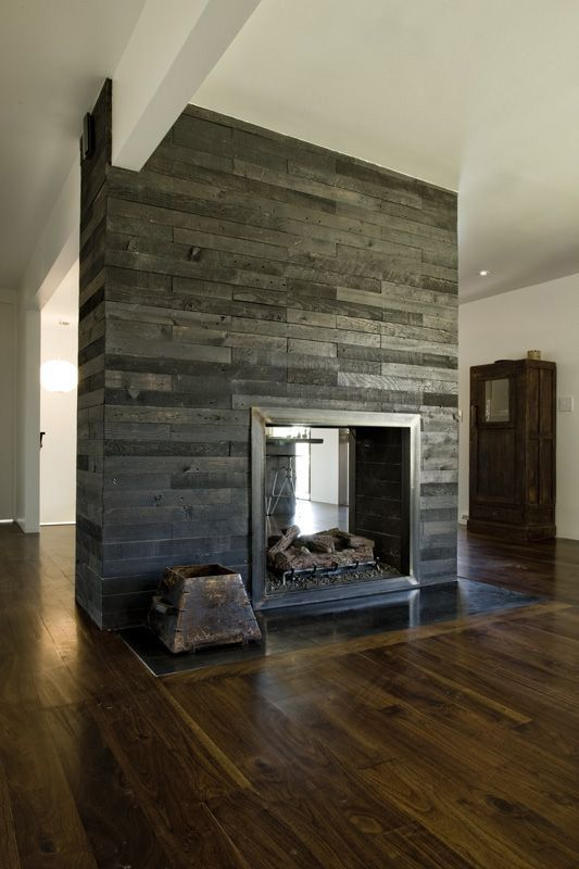 great combo of rustic grey reclaimed wood(I thought it was stone but it seems to be wood!) and warm distressed wood floors..love double sided fireplaces too. I LOVE this!!!!