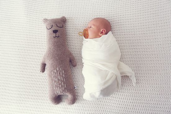 newborn photo idea: take a photo of your newborn next to one of their toys. Repeat at age one (or every month) to see their growth progress