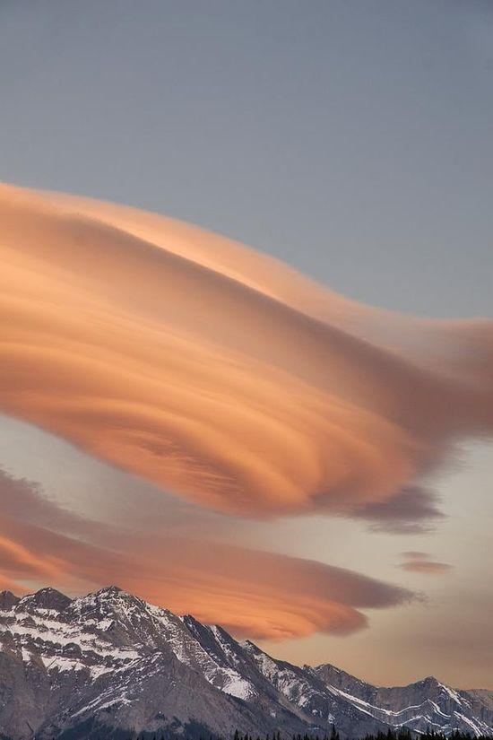 Lenticular clouds at Sunset above Mountain Peaks, Kootenay Plains, Alberta, Cana