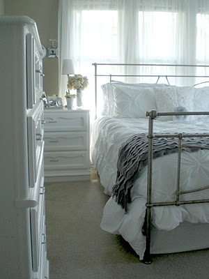 painted white bedroom furniture, metal bed in front of window