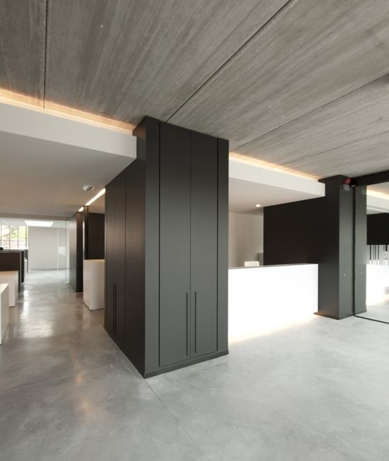 Hidden cupboards by Graux & Bayens. Nice office space.