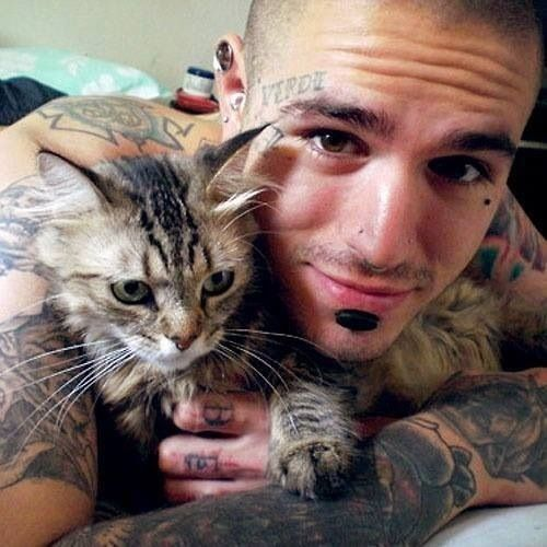 Hottie with tattoos and cute baby kitten