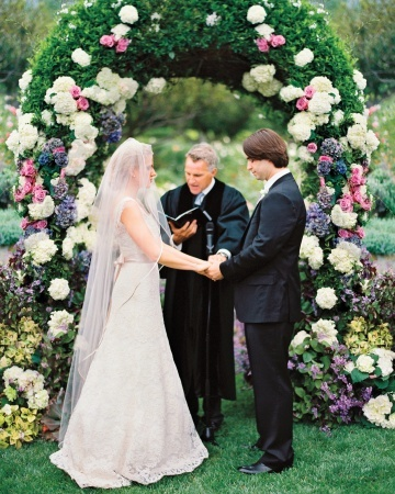 Dutch hydrangeas, and heirloom garden roses adorned this ceremony arch