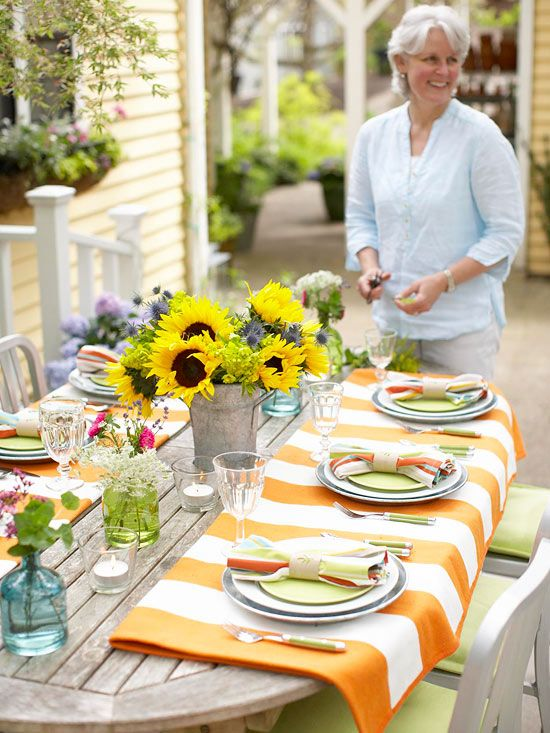 If your table is too large for a tablecloth, buy two of the same tablecloths and drape them over the ends of your table. More outdoor entertaining ideas: www.bhg.com/...