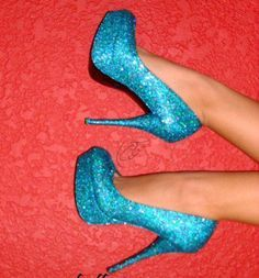 I like this pair of shoes because it's blue and they have glitter on them and plus if you have blue lipstick with glitter on it. It will look so cool I really like this pair of shoes because I like the blue glitter on them