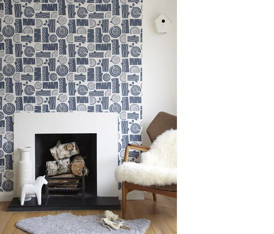 Fantastic wall paper around the fireplace.