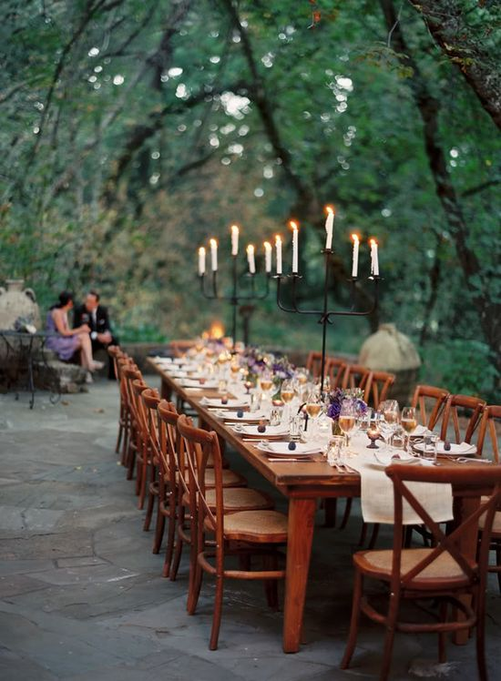 tall candles at outdoor wedding reception