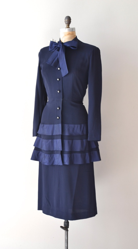 1940s navy blue crepe dress with rhinestone buttons.