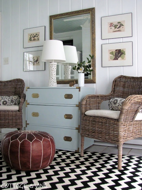 Yep...love this, too!  The rug, the pouf, the chairs, the color of that campaign style dresser...this gal is good!  (via cottage and vine)