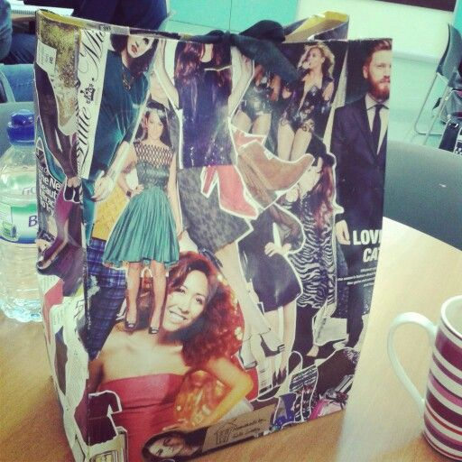 Hand made gift bag collaged in images from a fashion magazine