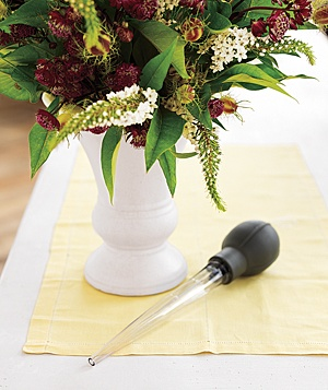 Change dirty water in a flower vase by using a turkey baster to suction up the liquid without disturbing your arrangement. Add fresh water directly from the tap.