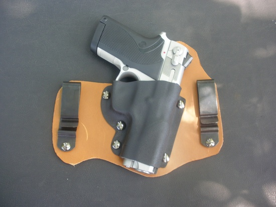 Inside the waistband holster for a Smith & Wesson 4513. 8-9oz leather with steel tuckable belt clips and a kydex shell. Starting at $50.00. I have access to most common handguns and I work with a local FFL for shipping of guns. Contact me about making a sheath for your gun!!! Handmade in U.S.A. Find us on Facebook REJck RedEyedJack custom knives of Bonifay, Florida E-mail mailto:redeyedjac...
