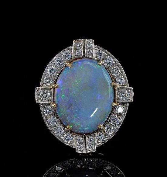 Late Art Deco solid opal and diamond ring