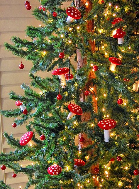 "Epic mushroom tree! These are so cute! felt mushrooms made with felt ""tube"" and two circles of felt and cardboard circle same size as smaller circle. Alternatively, I'm pretty sure either walmart or pier one had mushroom ornaments."