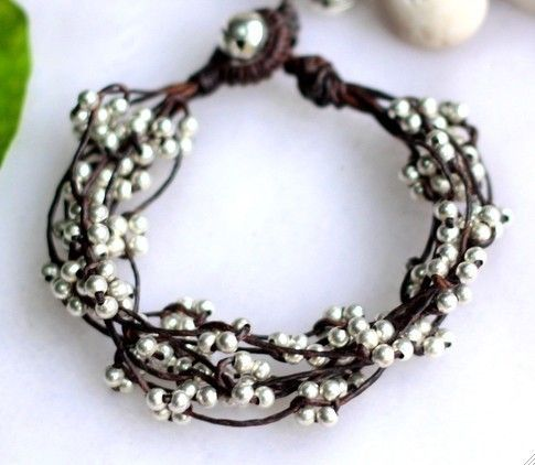 multistrand knotted bracelet with wee silver beads