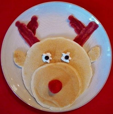 Great for the kids - Pancakes, bacon, strawberry nose, a little whipped cream and a couple chocolate chips.  Love it
