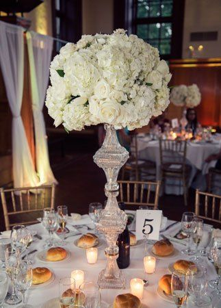 Tall white centerpiece with silver vase