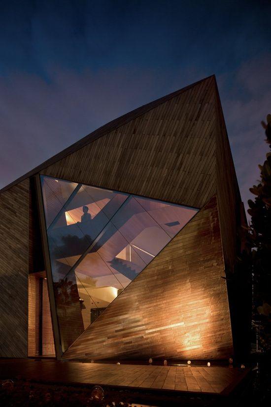 Triangular window contemporary facade