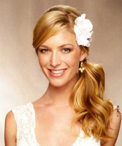 Ponytail wedding hairstyle with flower