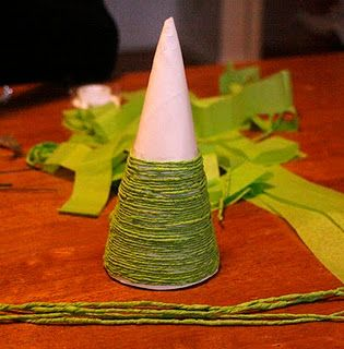 Use paper plates to make mini Christmas trees. WAY cheaper than the styro cones.   So clever!