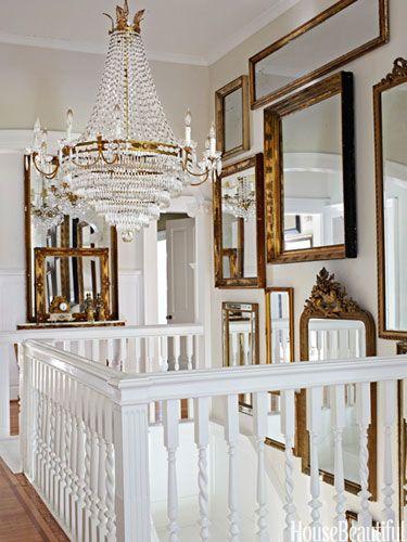 Salon-style mirrors in a stair hall. Design: Annie Brahler. #mirrors