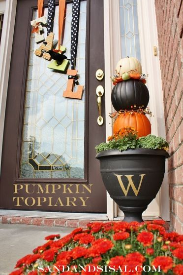 I love the fall letters on the door with the ribbon. The pumpkin topiary is out of dollar store pumpkins