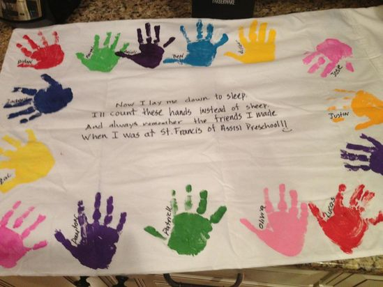 Pillowcase with hand prints of classmates – should do this for a retirement gift