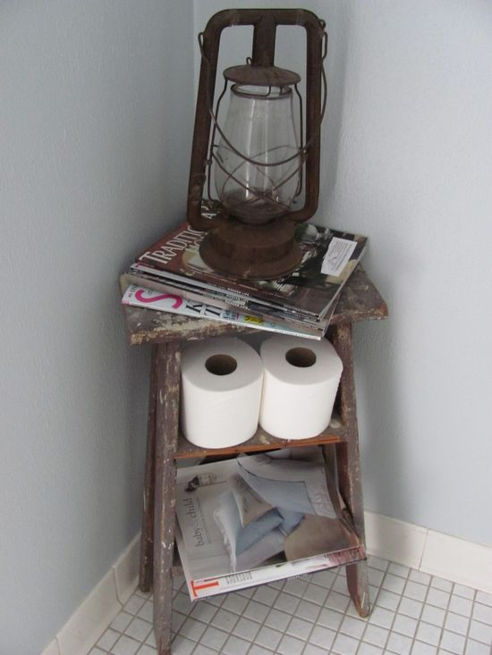 Old ladder turned magazine rack